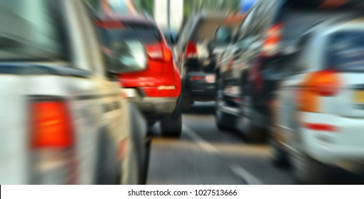 Modern traffic. Cars on a motorway. Road infrastructure. Congestion. Many vehicles. Urban landscape. Blur background.