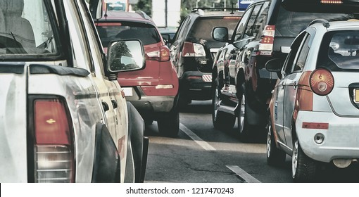 Modern traffic. Cars on a motorway. Road infrastructure. Congestion. Many vehicles. Urban landscape. Matte background. Black and White photography. Beautiful blur backdrop. Vintage. Old photo.