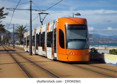 Modern tram serving passengers at southern Europe (Alicante, Spain)
