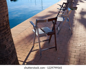 Modern trendy design street puclic chairs made of metal by the sea ocean