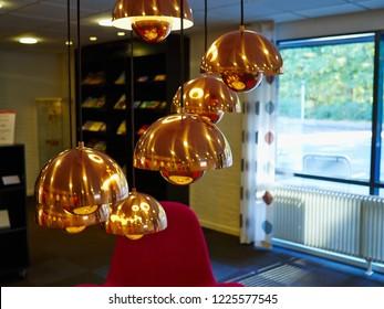 Modern trendy Scandinavian design copper bronze lamps hanged in a room