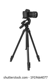 Modern tripod with camera isolated on white