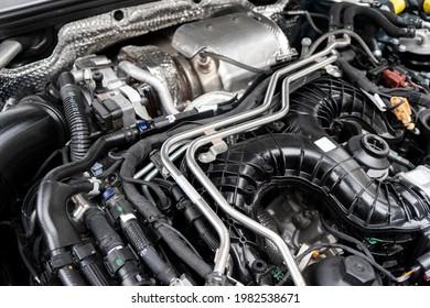 Modern turbo diesel car engine under vehicle hood. Car engine background. Car engine part. Modern powerful engine.