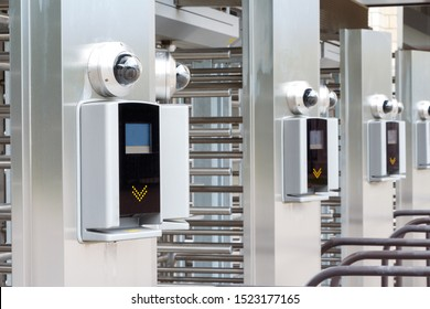 Modern turnstile at the stadium. Card access system, video surveillance, scanner, barrier. Close up.