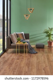 Modern turquoise and green wall background home corner sofa with wooden lamp. Yellow coffee table.