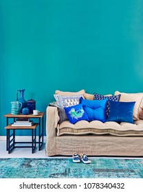 Modern turquoise living room concept. Interior planning decoration with furniture table sofa and lamp.