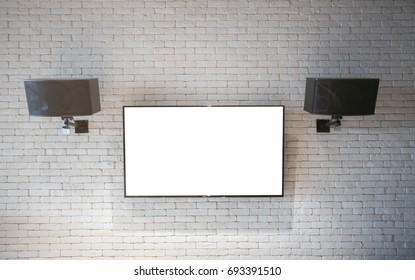 modern TV screen on white wall.