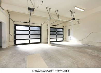 Modern two cars garage with glass doors.