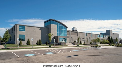 Modern Two-story Gray Building with Concave Entrance