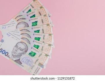 Modern Ukrainian money on pink background - hryvnia . 500 banknotes. UAH. Money concept.