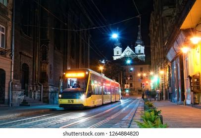 Modern ukrainian tram in old city center of Lviv. Lvov, Ukraine.