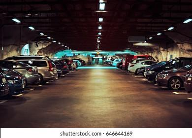 Modern underground parking with cars