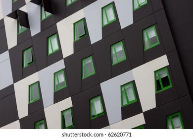 Modern unit design with distinctive green windows.