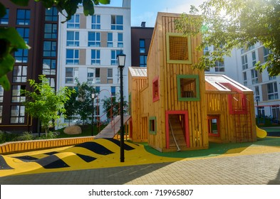 Modern unusual bright wooden playground (children's lodge) in the new suburban residential complex