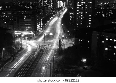 Modern Urban City at Night with Freeway Traffic, black and white