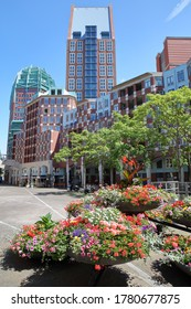 Modern urban development located on Muzenplein, The Hague, Netherlands, with colorful flowers in the foreground