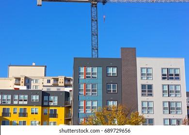 Modern urban development in suburbs of Washington DC. Newly build residential community under a blue clear sky.