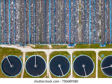 Modern urban wastewater treatment plant from aerial view.Water purification is the process of removing undesirable chemicals, suspended solids from contaminated water.Water cleaning facility outdoors.