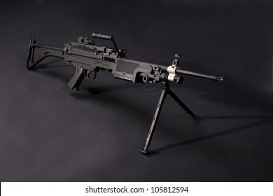 modern us army machine gun on black background