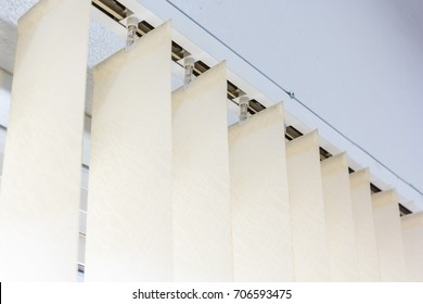 Modern vertical blinds on the window of the office