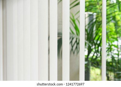 Modern vertical fabric blinds on the window in the office