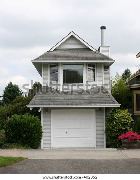 A modern but very narrow house built on a small lot.  Location: Vancouver, BC, Canada