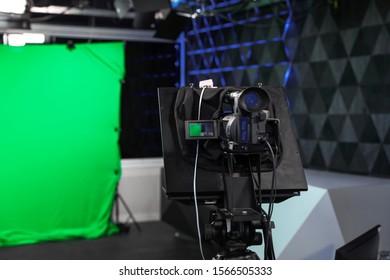Modern video recording studio with professional equipment, focus on camera