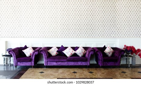 Modern Vintage Interior design. Living room. Purple sofa on marble floor.