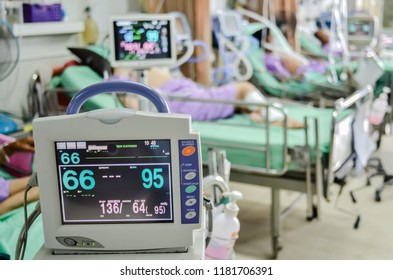 Modern vital sign monitor on patient background at ward in the hospital blurred.