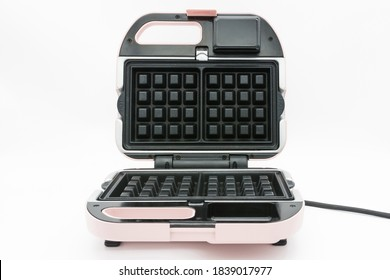Modern waffle maker isolated on the white background.