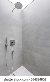 Modern walk in shower with gray wall tiles