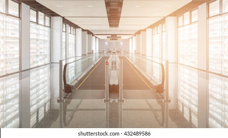Modern walkway of escalator move forward and escalator move backward in international airport. Escalator is facility for support transportation in modern building