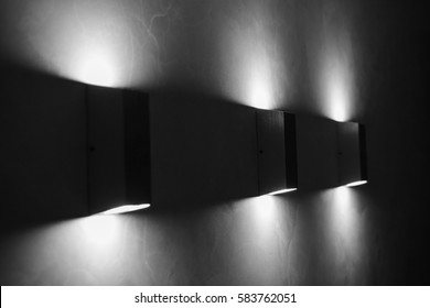 Modern wall lamps on wall. dark style