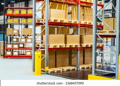 Modern warehouse interior. Cardboard boxes on the racks. Boxes with barcode in stock. The organization of warehousing. Responsible storage. Warehouse storage. mobile storage racks.