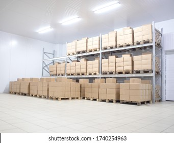 Modern warehouse refrigerator finished goods in cardboard boxes, background. Pharmaceutical Storage Concept, copy space