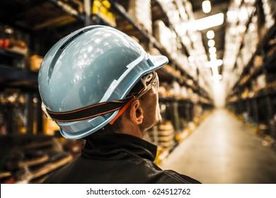Modern Warehouse Worker in Safety Helmet