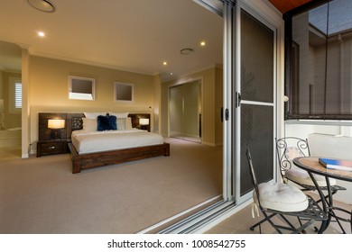 Modern, warm, cozy bedroom in luxurious home