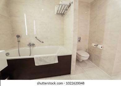 Modern warm designer bathroom with shower tiling