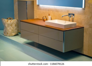 Modern Wash Basin with in wall faucet spout and vanity brown yellow orange wall