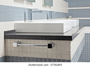 Modern wash stand in blue and gray tones with mosaic