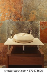 Modern Washbasin in bathroom with stone wall