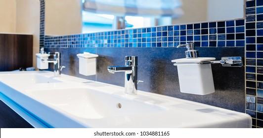 Modern washbasin faucet and washbasin in the bathroom