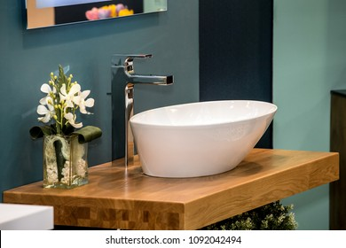 Modern washbasin with mixer tap in bathroom