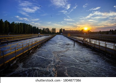 Modern wastewater treatment plant. Tanks for aeration and biological purification of sewage at sunset