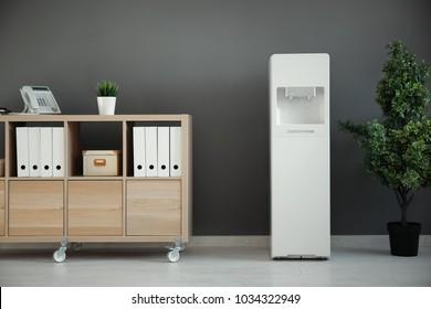 Modern water cooler in office