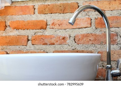 Modern water faucet on the sink