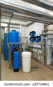 Modern water treatment system with automatic control units in industrial gas boiler house.