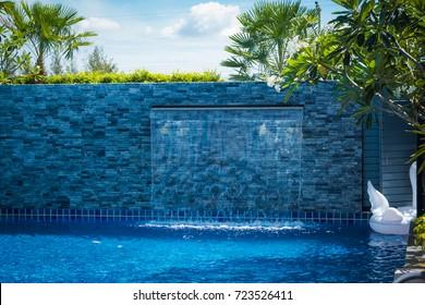 Modern Waterfall Wall in Blue Swimming Pool