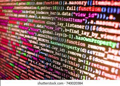 Modern web network and internet telecommunication technology. Programming code typing. Website codes on computer monitor. Displaying program code on computer. Webdesigner Workstation.