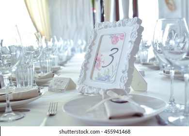 Modern Wedding Decorated Table. Frame with Numbers